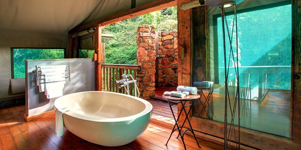 En-suite bathrooms at Botlierskop are equipped with deep baths and outdoor bush showers
