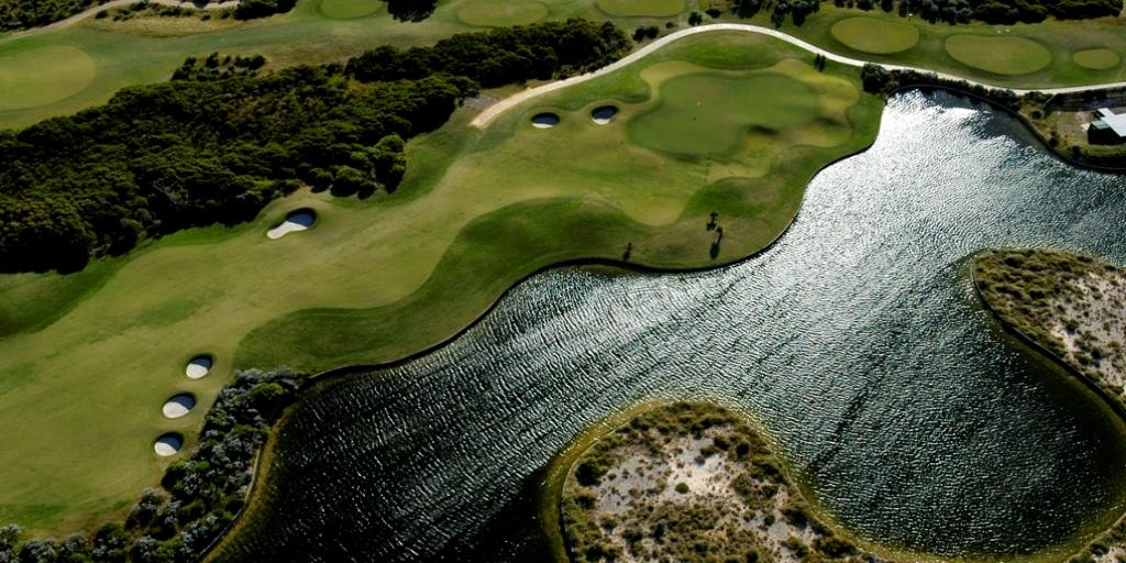 Hole 1 Aerial View at Kennedy Bay GC